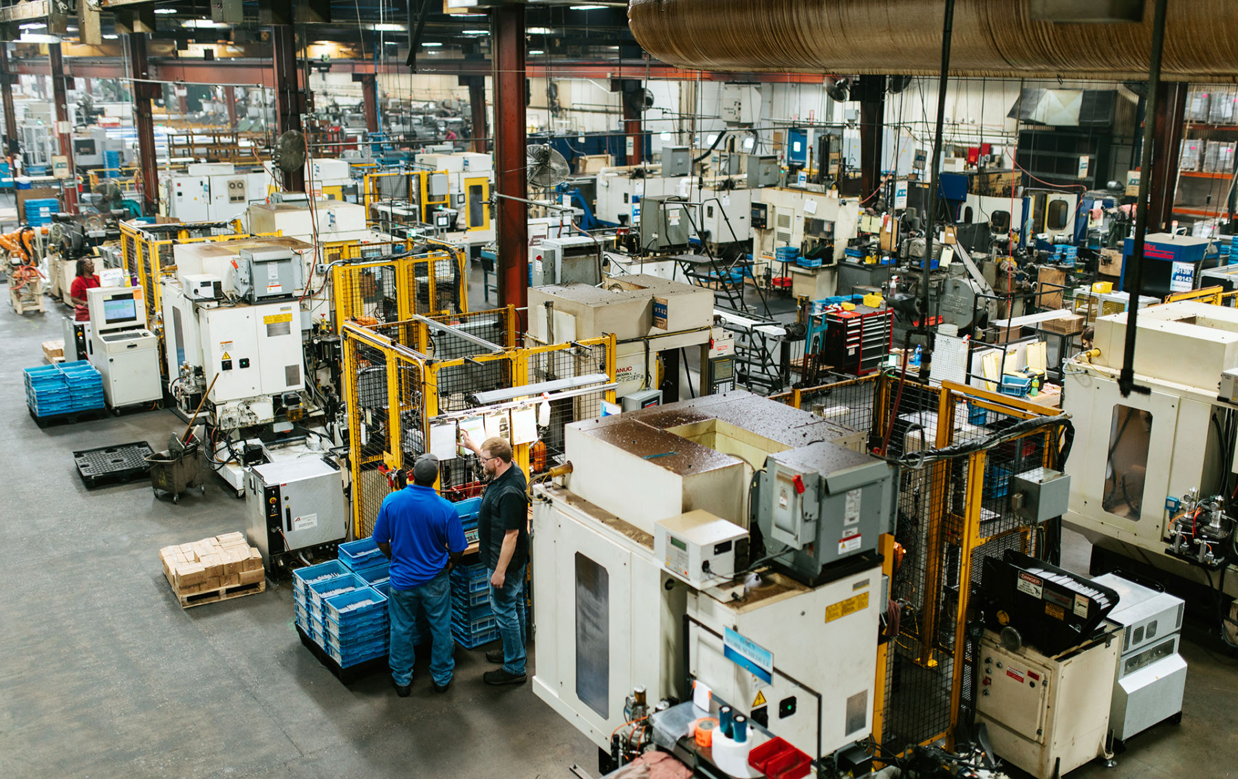 people talking on a plant floor   machine builder solutions