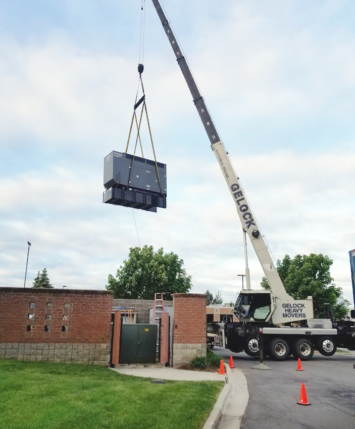generator being lifted by a crane