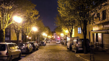 town street with outdoor lighting at night