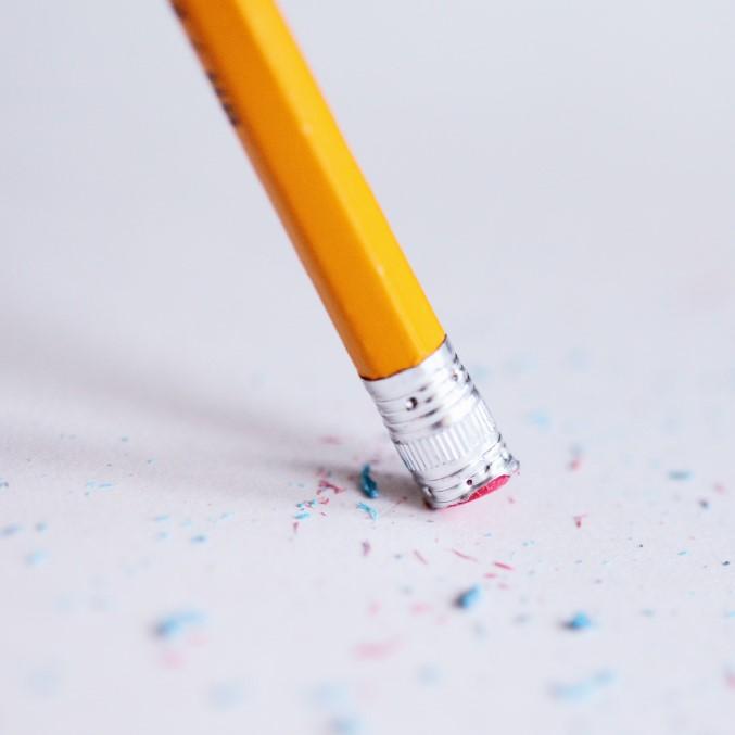 pencil erasing a page